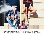 a man smoking a hookah sitting...   Shutterstock . vector #1196761963