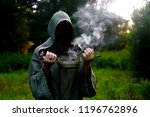shaman with a censer inflates... | Shutterstock . vector #1196762896