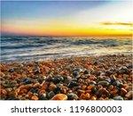 Waves On A Pebble Beach Under A ...