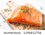 Stock photo salmon fish uncooked salmon fillet with lemon sea salt and rosemary on white close up 1196812756