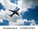 airplane over the clouds  the... | Shutterstock . vector #1196831983