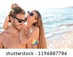 happy young couple in beachwear ... | Shutterstock . vector #1196887786