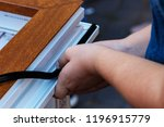 professional sealing a window... | Shutterstock . vector #1196915779