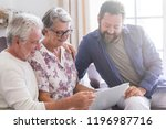 family team at work at home sit ... | Shutterstock . vector #1196987716
