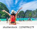 happy active traveler woman joy ... | Shutterstock . vector #1196996179