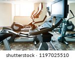 group of exercise bicycles in... | Shutterstock . vector #1197025510