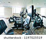 group of exercise bicycles in... | Shutterstock . vector #1197025519