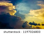 Small photo of Dramatic cloudscape on a summer evening, for background with motifs of weather, turmoil, transition