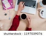 woman hand's holding cup of... | Shutterstock . vector #1197039076