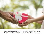 a red heart box present given... | Shutterstock . vector #1197087196
