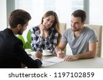 young couple signs contract... | Shutterstock . vector #1197102859