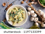 penne pasta with spinach ... | Shutterstock . vector #1197133399