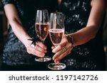 friends celebrating christmas... | Shutterstock . vector #1197142726