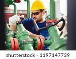 oil worker turning valve on oil ...   Shutterstock . vector #1197147739