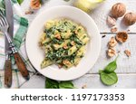 penne pasta with spinach ... | Shutterstock . vector #1197173353