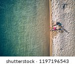 beautiful beach with family top ...   Shutterstock . vector #1197196543