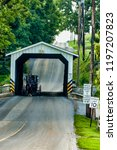 amish covered bridge buggy...   Shutterstock . vector #1197207823