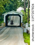 amish covered bridge buggy...   Shutterstock . vector #1197207826