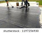 roofer worker painting bitumen... | Shutterstock . vector #1197256930