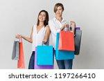 two beautiful female friends on ... | Shutterstock . vector #1197266410