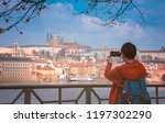 back view of young man takes... | Shutterstock . vector #1197302290