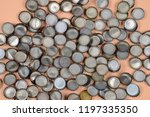 pile of bottle caps on a nude... | Shutterstock . vector #1197335350