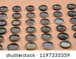 bottle caps lined up in color... | Shutterstock . vector #1197335359