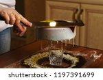 cook preparing mousse cake... | Shutterstock . vector #1197391699