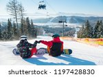 snowboarders resting on the top ... | Shutterstock . vector #1197428830
