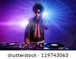 nightclub dj playing music on... | Shutterstock . vector #119743063