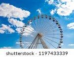 ferris wheel on a fairground in ...   Shutterstock . vector #1197433339