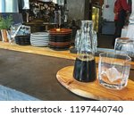iced black coffee in glass | Shutterstock . vector #1197440740