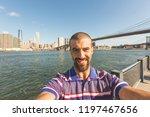 man taking a selfie in new york ... | Shutterstock . vector #1197467656