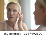 40 year old woman looking at... | Shutterstock . vector #1197492820