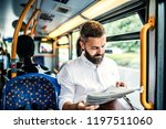 hipster man on a bus in the... | Shutterstock . vector #1197511060