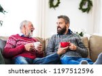 a senior father and adult son... | Shutterstock . vector #1197512596