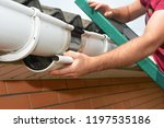 guttering repair. roofer... | Shutterstock . vector #1197535186