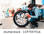 young smiling mechanic cleans a ... | Shutterstock . vector #1197547516