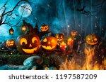 halloween pumpkins on dark... | Shutterstock . vector #1197587209