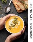person holding bowl of pumpkin... | Shutterstock . vector #1197587719