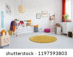 orange round rug and posters in ... | Shutterstock . vector #1197593803