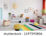 poufs on colorful rug in scandi ...   Shutterstock . vector #1197593806