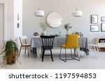 black and yellow chair at table ... | Shutterstock . vector #1197594853