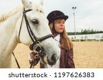 girls learn how to ride horses | Shutterstock . vector #1197626383