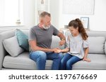 senior man checking little girl'... | Shutterstock . vector #1197676669
