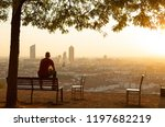 man on a bench in a park... | Shutterstock . vector #1197682219