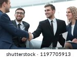 handshake of business people at ... | Shutterstock . vector #1197705913