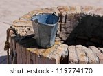 A Water Well With An Old Bucket ...