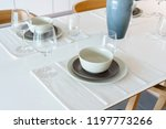 table set on wood dinning table ... | Shutterstock . vector #1197773266