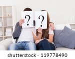 Couple In The Living Room With...